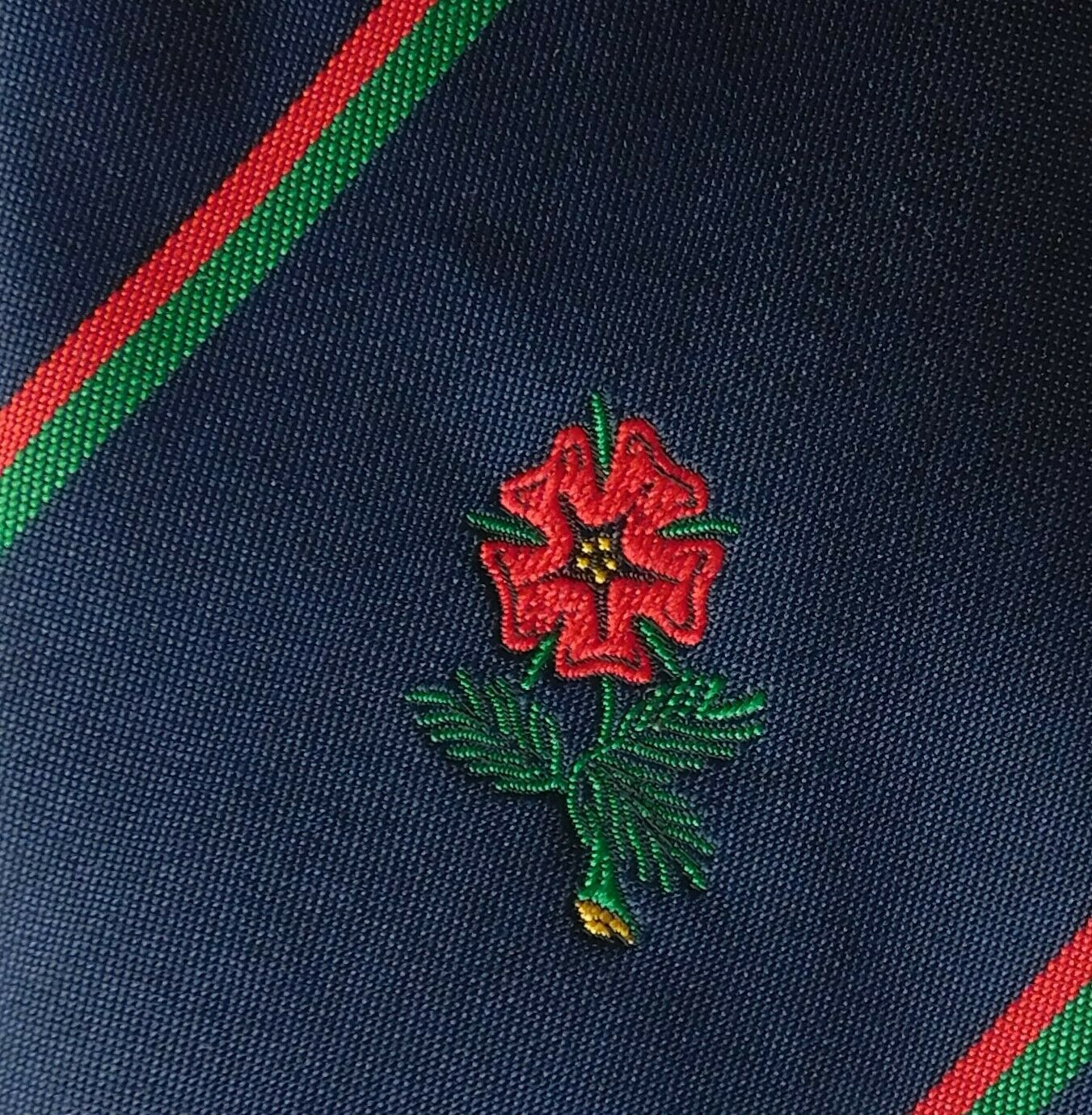 Vintage tie with red flower rose? possibly rugby club company logo badge emblem