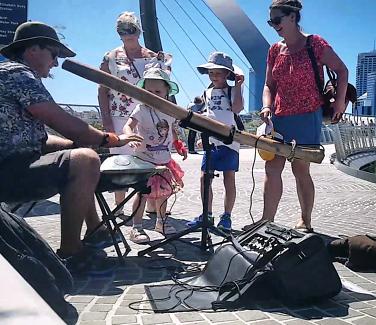 Didgeridoo and handpan busker musician entertainer teacher