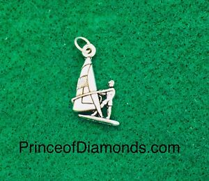 Silver coloured boating pendant charm