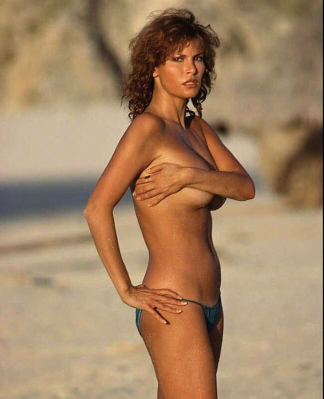 Racquel Welch - In Bikini Bottoms And Topless But Holding Them !!!??