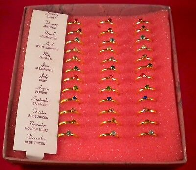 wholesale lot - 36 birthstone rings w/display wholesale 40 cents each ships free
