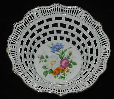 A CLUJ NAPOCA OF ROMANIA RETICULATED PORCELAIN BOWL W/ FLORAL BOUQUET THEME