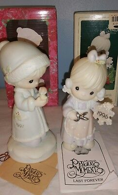 Precious moments figurines . #524166  & 1995 .#142654 Holiday figures