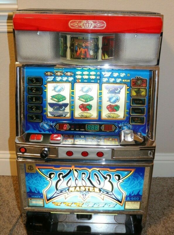 TAROT MASTER TOKEN SLOT MACHINE A-600 MANUAL WITH TOKENS