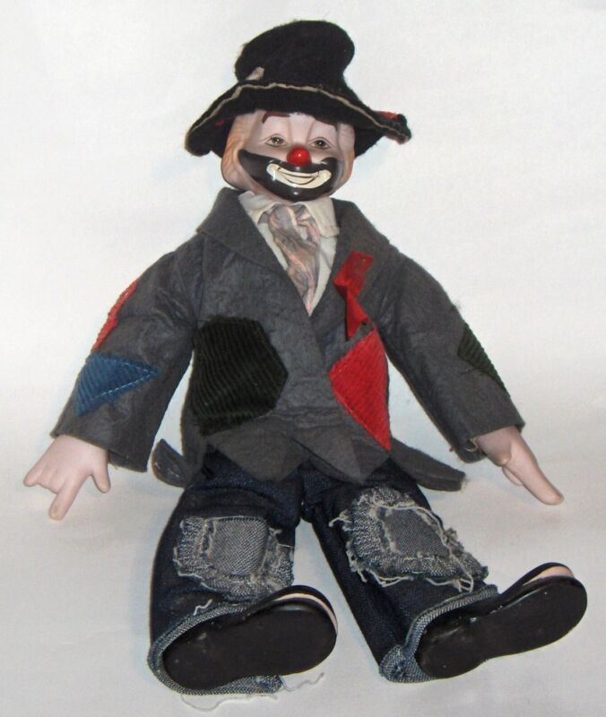 porcelain clown/hobo cloth body - felt clothes/hat --(non working) wind up key