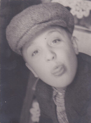 1950s Cute funny boy showing tongue grimaces in hat fashion Russian Soviet photo
