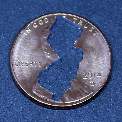 Lucky penny with New Jersey cut out