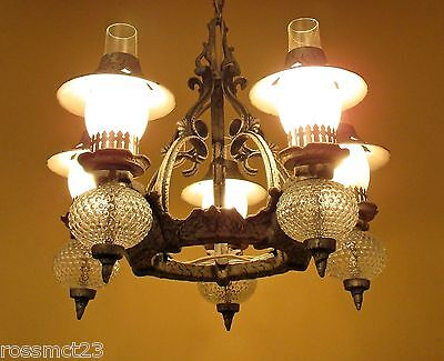 Vintage Lighting striking 1930s Spanish Tudor chandelier, and two sconces