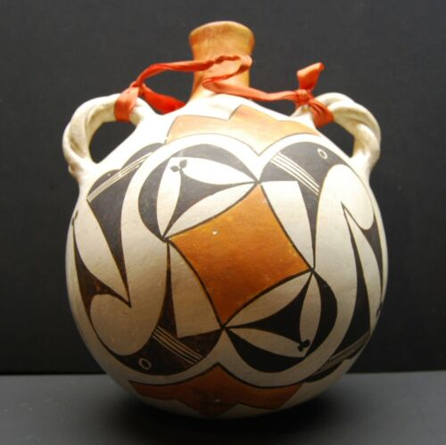 An early Acoma pottery canteen, Native American Indian, Circa: 1930/40