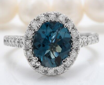 6.60 Carat Natural London Blue Topaz and Diamonds in 14K Solid White Gold Ring