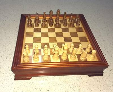 Nice wooden chess set with board and piece storage