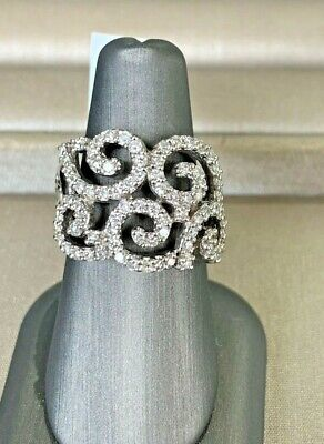 Swirl Design Diamond Ring with app. 1 ct total weight of diamonds set in 14k wg