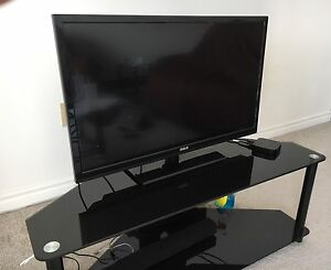 LED TV with black glass stand