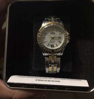 Brand new never worn elite woman's two tone/mother of pearl watch