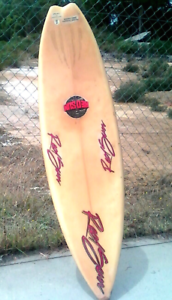 Vintage surfboard, red sun.designed by scott whylie.