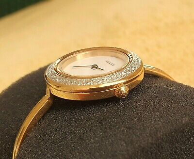Gucci 11/12.2 18k GP Women's Bangle Watch with Diamond Cut metal Bezel (NR536)