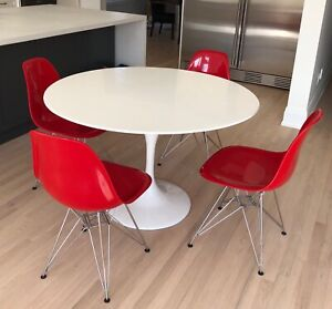 White tulip table with up to 6 glossy red Eiffel chairs