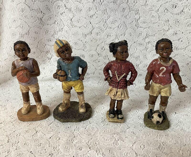 "VINTAGE BLACK AMERICANA RESIN FIGURINES CHILDREN PLAYING SPORTS APROX 6"""
