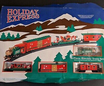 Holiday Express 4 piece Electric Train Set Christmas Santa's (transformer works)