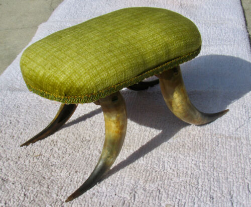 Small foot stool/milking stool upholstered legs are horns