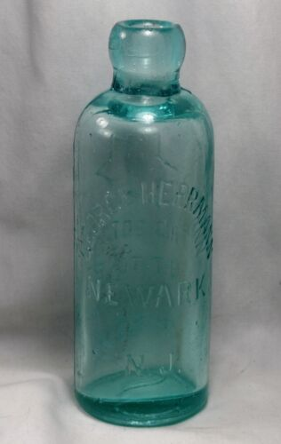 Antique 'GEORGE HERRMANN Newark, NJ' Hutchinson blob soda bottle