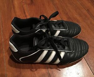 Two pairs of Youth Adidas soccer cleats