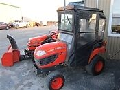 2012 Kubota BX2660 Tractor with mid mount mower