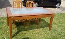 Dining table - wooden with glass top