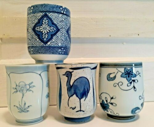 Collection of four Unique Blue and White Asian Tea Cups