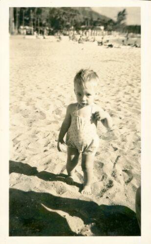 1940 Waikiki Beach scene  cute toddler, Kuhio Beach area,  Hawaii  Photo