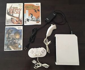 Nintendo Wii Bundle - Console, Two Controllers, & Three Games