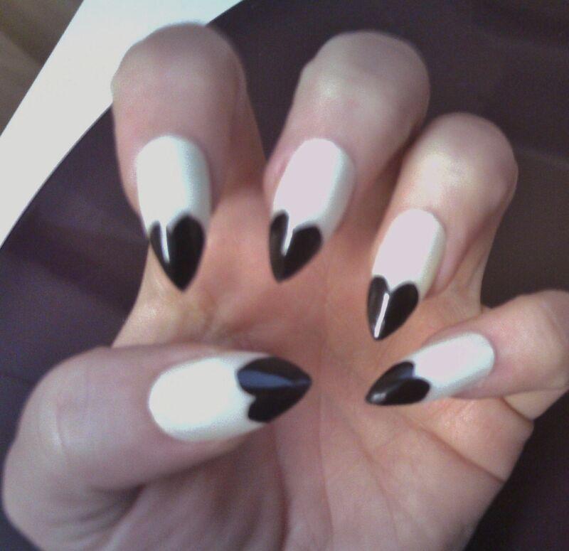 Black heart on nude stiletto nails