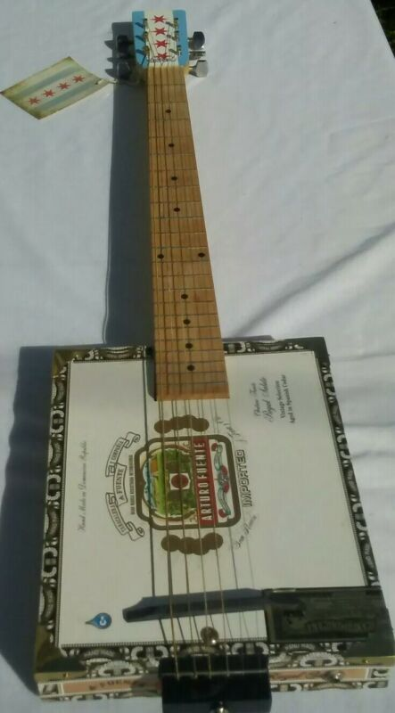 Amazing Six String Arturo Fuente Cigar Box Guitar by Four Star products