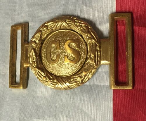 Civil War Belt buckles (3) and a breast plate.