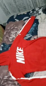 Red Nike jumper