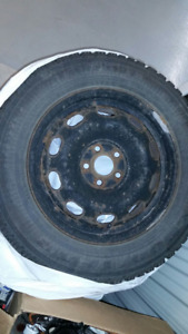 For Sale - 2 separate sets of 4 winter tires(used) on metal rims