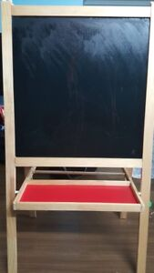Used Elmo table with two chairs and IKea white and black board