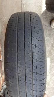 Commodore tyre/rim -Bridgestone P195/75R14 -suit trailer or spare Rankin Park Newcastle Area Preview