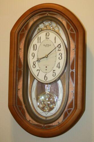Small World Rhythm Nostalgia Oak Musical Clock with Pendulum