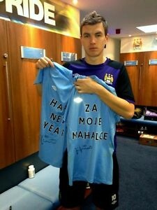Man-City-Umbro-T-shirts-worn-and-signed-by-Edin-Dzeko-with-custom-messages