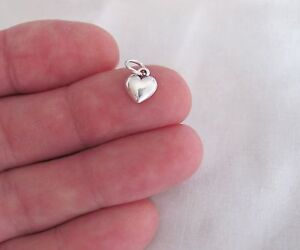 Sterling Silver tiny puffed Heart miniature charm.