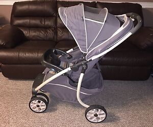 Graco LUX baby stroller with car seat and car base