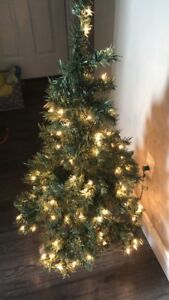 Brand New - only used once 4ft Christmas Tree ( pre lit )