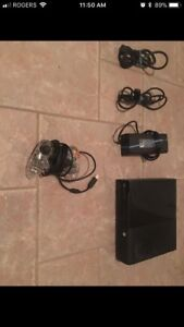 Xbox 360 slim with 5 controllers and 30 games