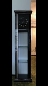 Tall clock with shelves