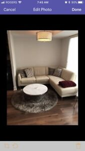 Beige sectional leather couch