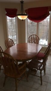 Gently used  solid oak dining set