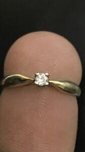 Lady's gold diamond ring.