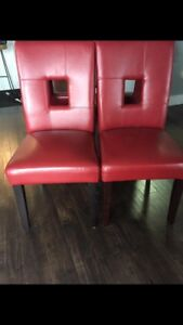 4 red leather chairs