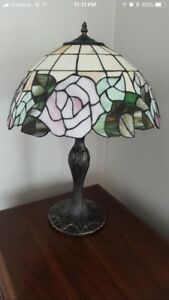 Stained glass Tiffany lamps. Two table and one standing
